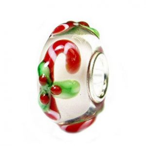 A round glass bead with Christmas Candy Cane and holly leaves